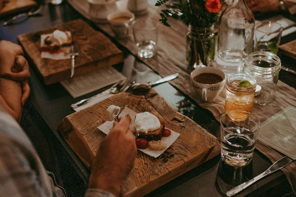 A beautifully curated place setting with a meal served on a wooden board